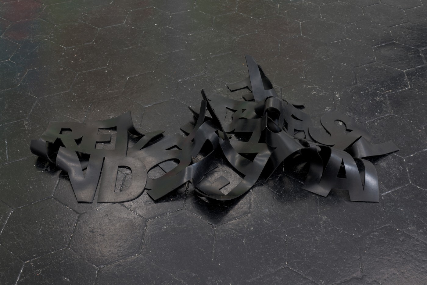 IN ESCROW  Remove the Outside and the Inside Remains</I>, 2016  Industrial grade rubber  Approx. 60 x 120 cm / 23.6 x 47.2 in  DENA YAGO