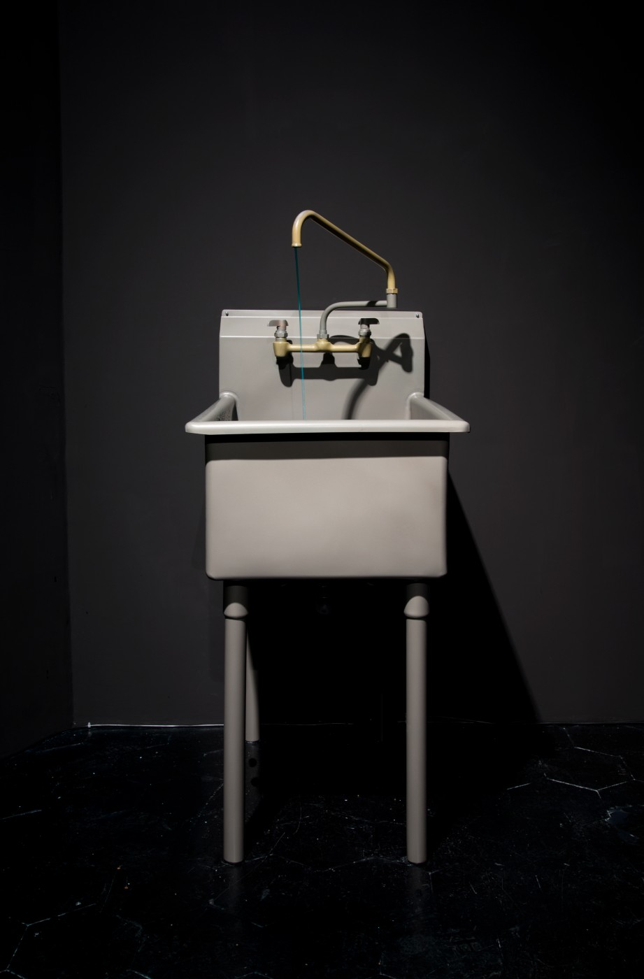 NATURE THEATER OF VIOLENT SUCCESSION  Sink From Foreclosed Morgue</I>, 2015 Salvaged refurbished utility sink, live freshwater ecosystem, biological filter pump, clear tubing, blue water dye, Cyprinid sp. fish  134 x 52 x 76 cm / 52.7 x 20.4 x 30 in  MAX HOOPER SCHNEIDER