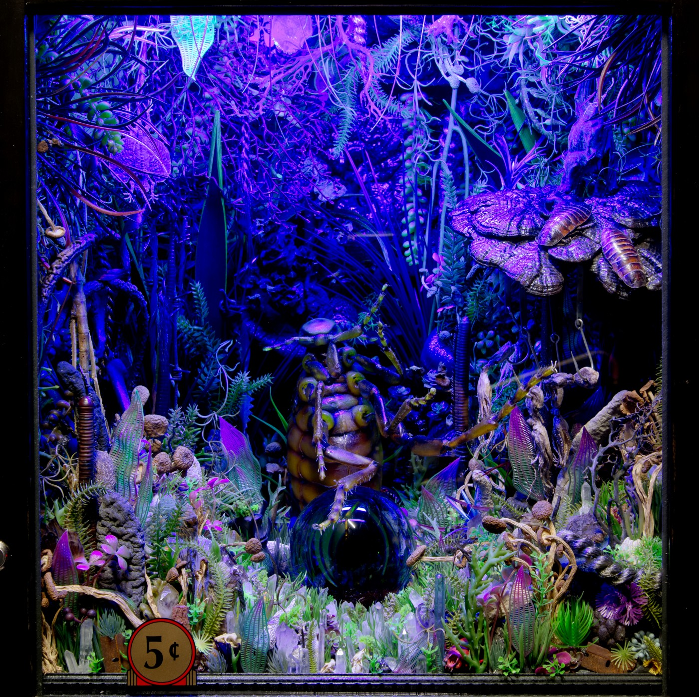 NATURE THEATER OF VIOLENT SUCCESSION  The Plaguewielder</I>, 2015 (detail) Custom fortune teller cabinet, animatronic flea model, aluminum sloping plinth, blacklights, crystal ball and rotating stand, custom fortune cards, plastic flora, dried organic flora, assorted crystals, animal and marine invertebrate matter, taxonomic specimens, assorted dried fungi, fish hooks, coprolites, dried mealworms, modeled acrylic windows, plastic screening 180 x 57 x 51 cm / 71 x 22.4 x 20 in   MAX HOOPER SCHNEIDER