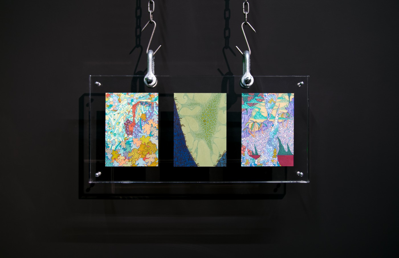 NATURE THEATER OF VIOLENT SUCCESSION  Landscape Triptych</I>, 2015  Pen and marker drawings, acrylic sandwich frame, custom hardware, meathooks, chains 24 x 50 x 2.5 cm / 9.4 x 19.7 x 1 in  MAX HOOPER SCHNEIDER