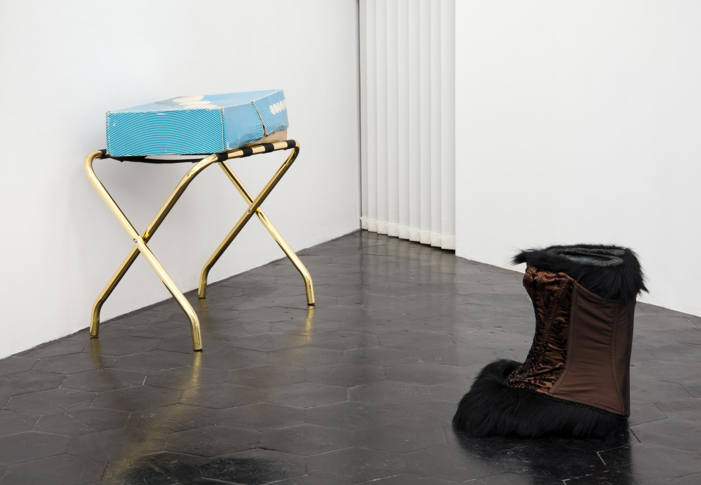 "RUINS IN THE SNOW Jessi Reaves + Brad Kronz  Sepia Disturbance</I>, 2017 Diadora ""Yeti"" boots with original box, corset, luggage stand Dimensions variable"