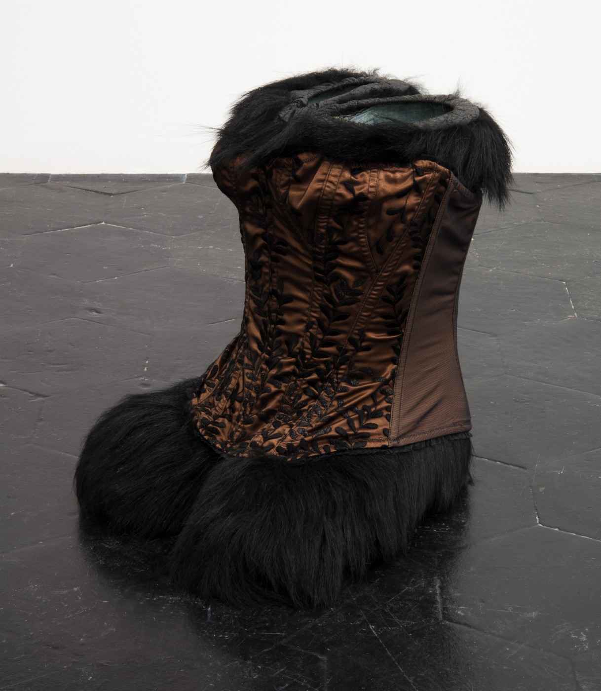 "RUINS IN THE SNOW Jessi Reaves + Brad Kronz  Sepia Disturbance</I>     (Detail), 2017 Diadora ""Yeti"" boots with original box, corset, luggage stand Dimensions variable"