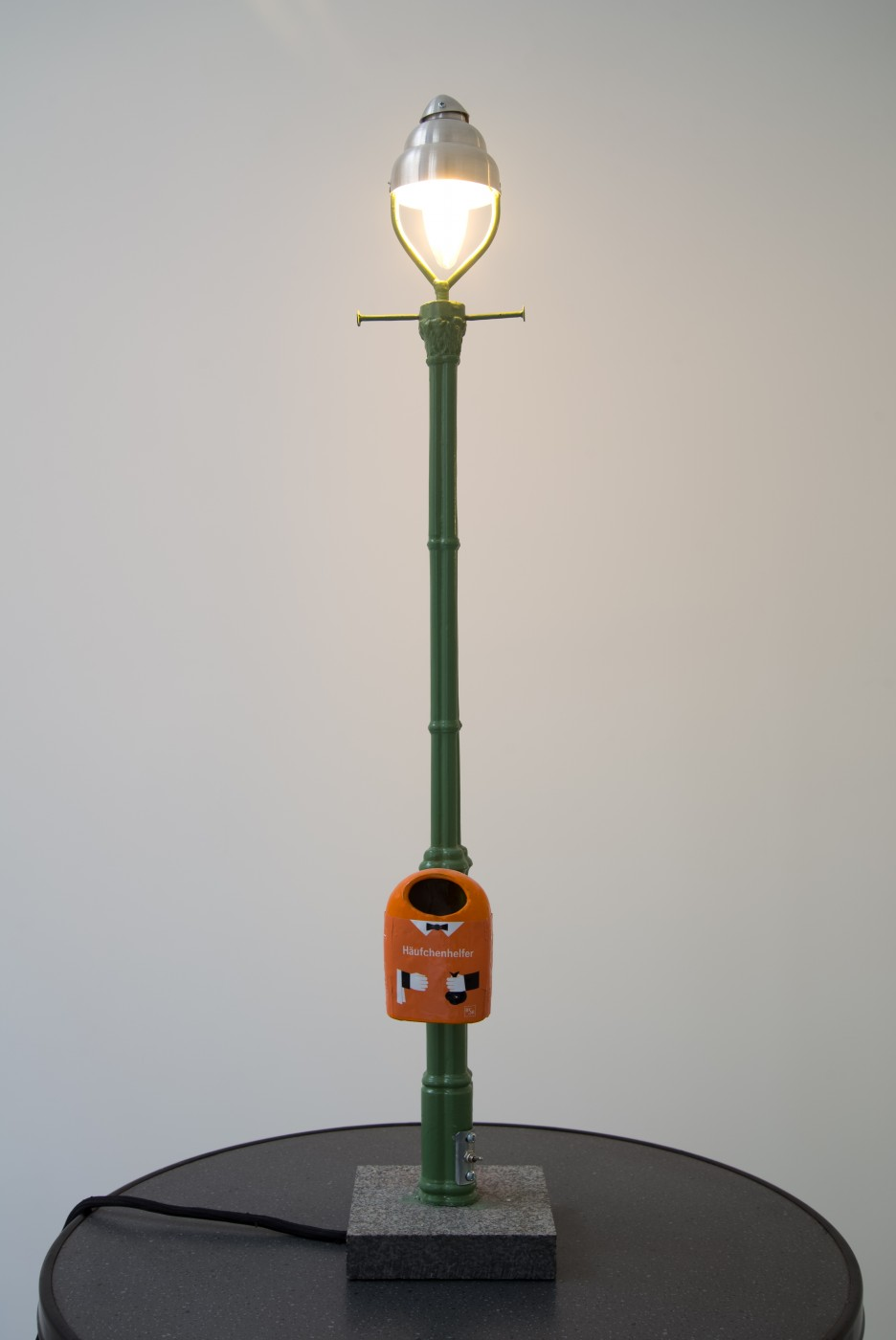 I&#8217;m Nobody! Pentti Monkkonen  Berlin Street Lamp (Häufchenhelfer)</I>, 2017 Steel, anodized aluminum, granite, paint, decal, electrical components 116 x 49 x 49 cm / 45.6 x 19.2 x 19.2 in